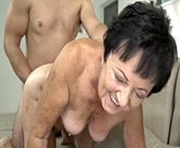Horny grandma fucks on couch with young man