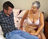 Horny granny with big tits fucks with a young cock
