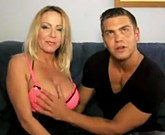 Busty MILF fucks with young boyfriend on the couch