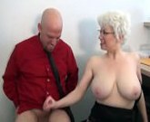 Hot blonde with Big Tits gives good handjob at the office