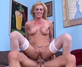 Hot blonde with big tits rides on big cock in white stockings