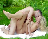 Romantic sex on a picnic blanket in nature