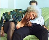 Young boy loves sex with busty granny