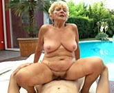 XXX Busty Grannies – Horny grandmother with big tits fucks next to a pool