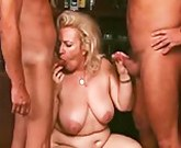German granny with big tits gets two cocks